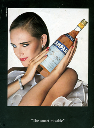 Attractive models are used to promote products. Campari is being presented in this advert with a sexually provocative look. The inferred connection is enhanced by adding the pornographic image to the bottle.