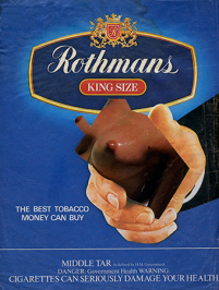 Smoking was heavily promoted in magazines in the 1980s. The different brands tried to encourage different aspirational lifestyles but fundamentally each was promoting, and profiting from, tobacco addiction. However the inserted image of breasts is asking a more fundamental question relating to seeking extra comfort where infantile act of thumb sucking is in turn a substitute for the mothers nipple during breast feeding.